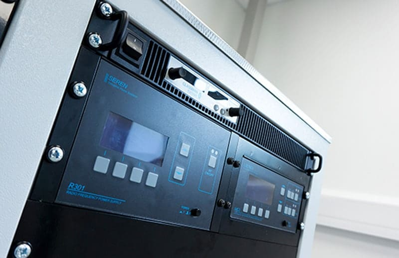 RF and DC power supplies mounted in the electronics rack of a MiniLab 060 magnetron sputtering tool. Recipe-based automated control is via a touchscreen HMI or PC
